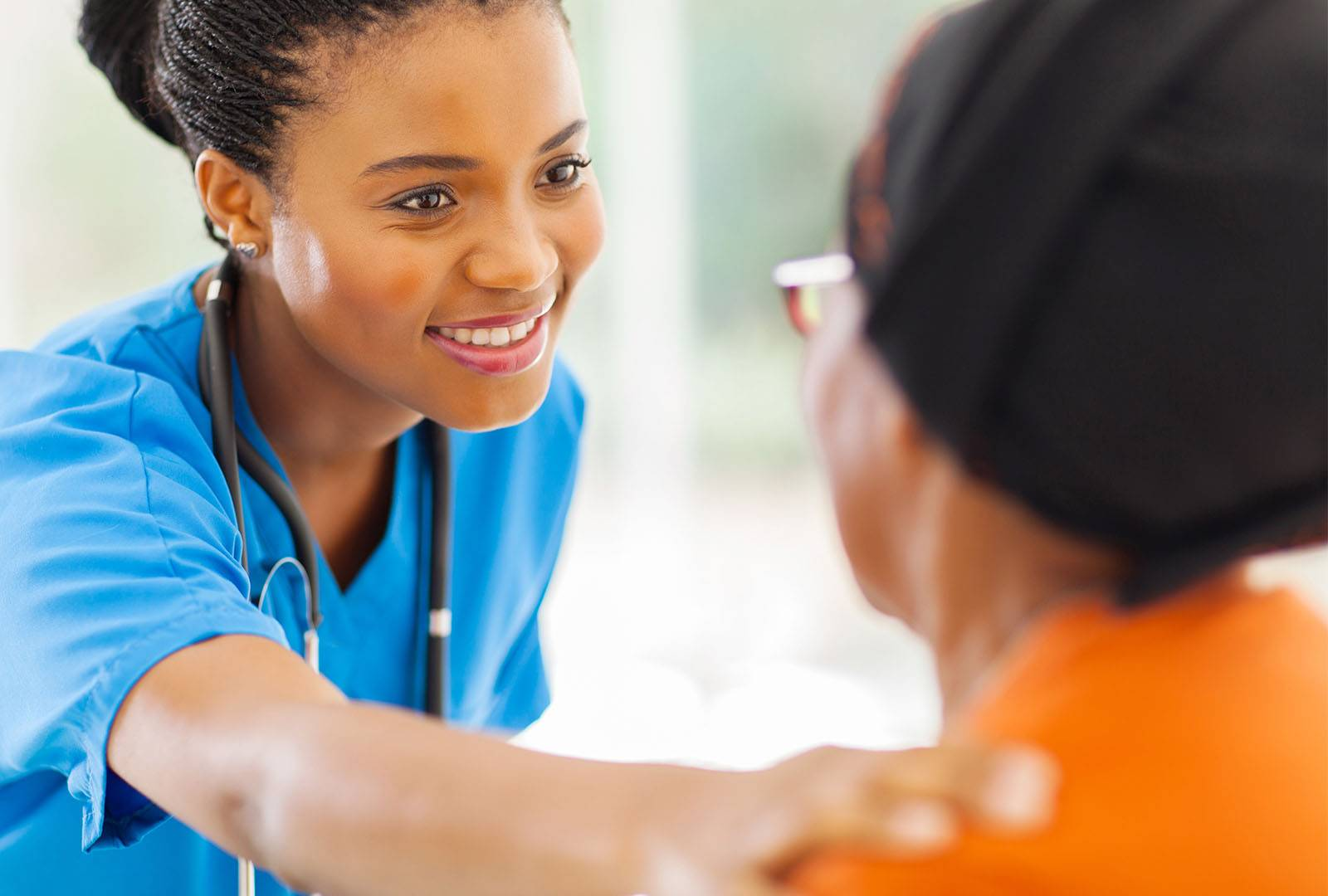 nurse working with patient smiling